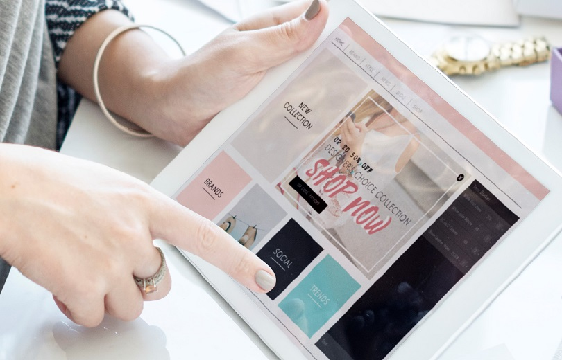 Woman using digital tablet for online shopping