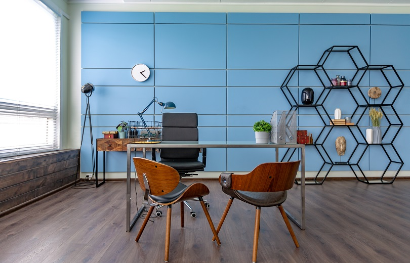 Modern trendy creative design of a personal studio office with a seating area in the style of minimalism in blue and beige colors with large windows and daylight